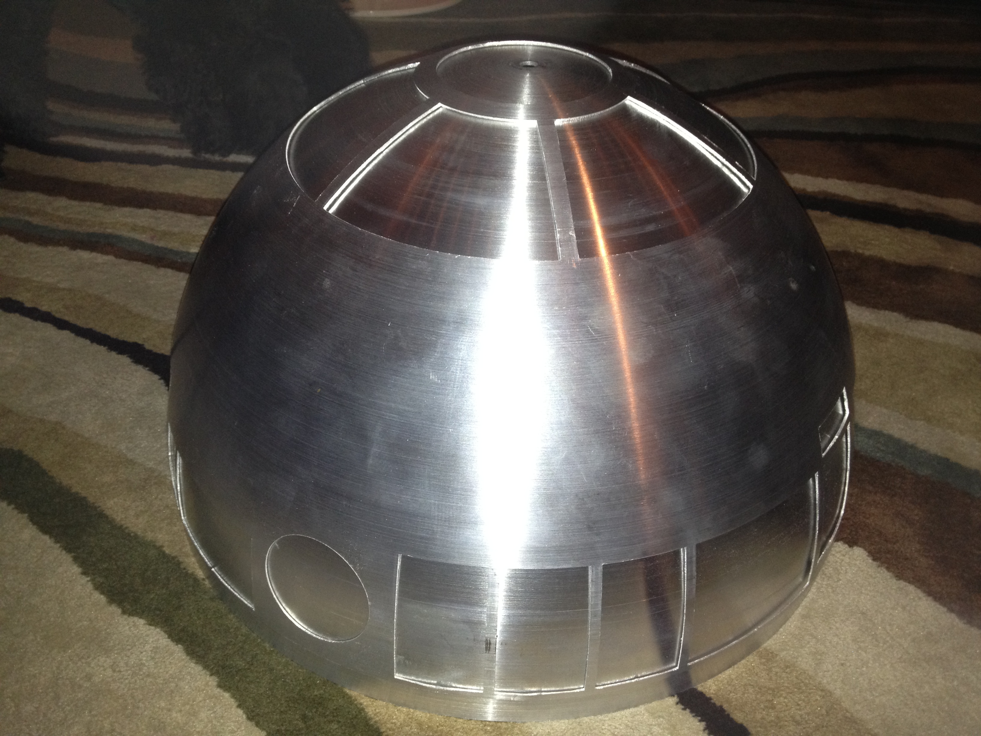 The safest place for the now cut outer dome to sit is resting on the solid inner dome.